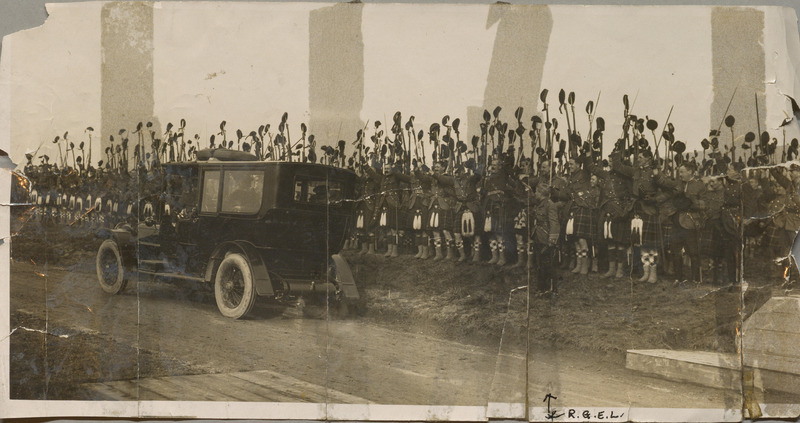 Photograph of R.G.E Leckie leading the Canadian 16th Battalion in cheering the automobile of King George V and Queen Mary with handwritten key