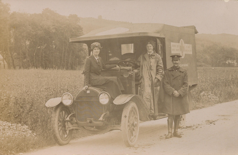 Photograph of women ambulance drivers and ambulance workshop in France